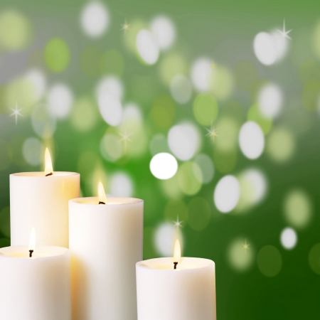 candle light: Image of candle light over blur green background Stock Photo