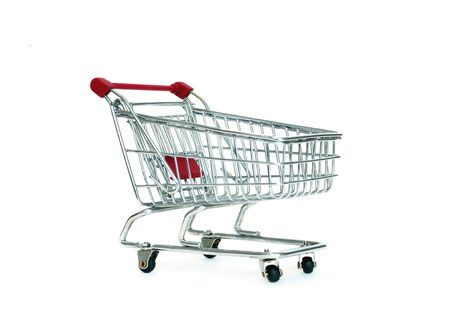 inexpensive: image of red shopping cart over white Stock Photo