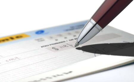 Business image of person writing a check photo
