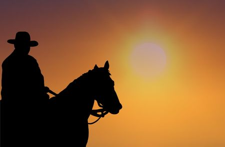 日没のカウボーイ 写真素材