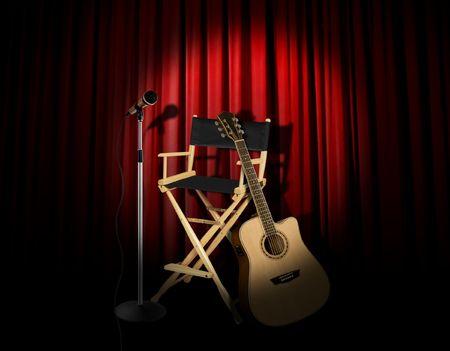 ステージ上でアコースティック ギター パフォーマンス
