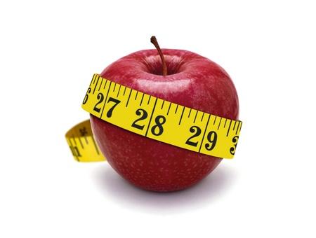 赤いリンゴと測定テープ