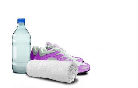 A bottle of water, joggers shoe and a sports towel