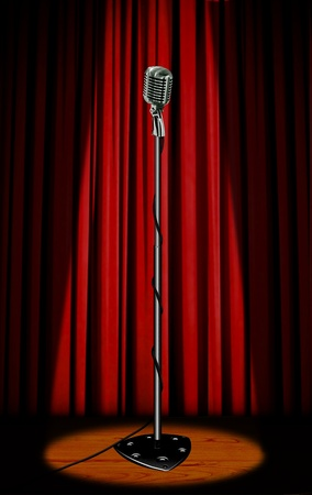 red stage curtain: Vintage microphone with red curtain
