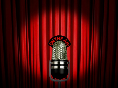 vintage microphone on air over red curtain photo