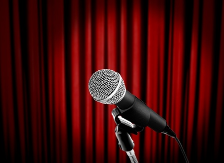 microphone on stage with red curtain photo