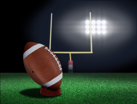 touchdown: Football on tee ready to be kicked off Stock Photo