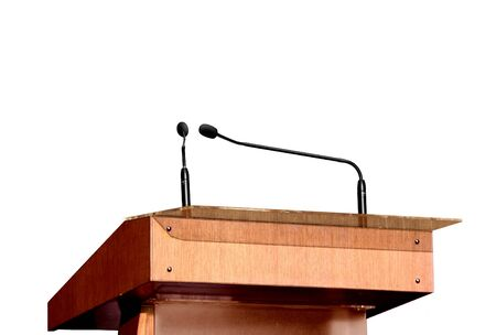 Seminar podium and microphones over white photo