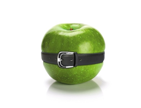 fat belly: Diet concept-green apple with belt
