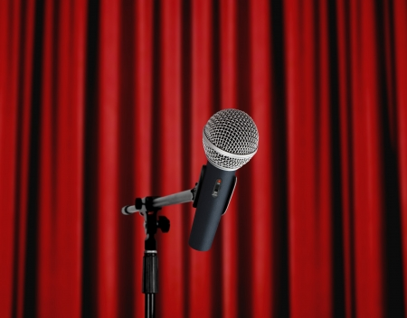Microphone standing over red curtain photo