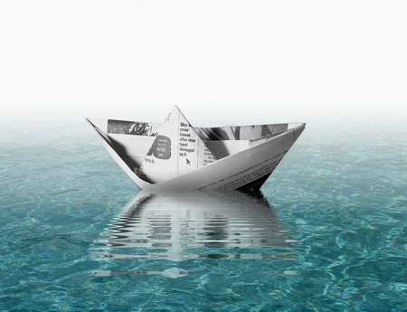 separate: Paper boat on water