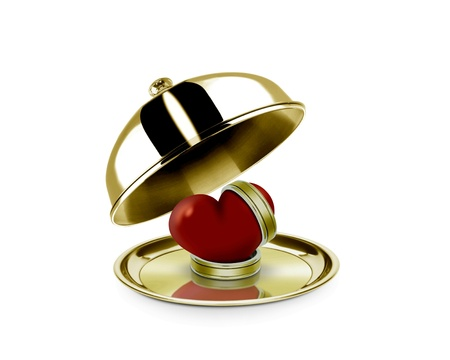 Heart and ring on a golden platter photo