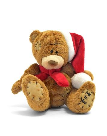 osos navideños: Oso de peluche con gorro de navidad