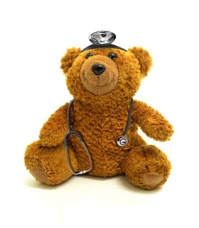 ourson: Ours de jouet avec son st�thoscope et projecteurs Banque d'images