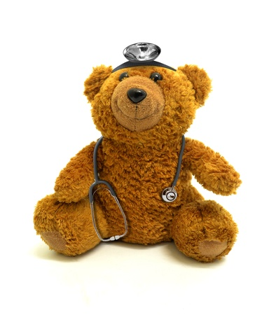 Toy bear with stethoscope and headlamp photo