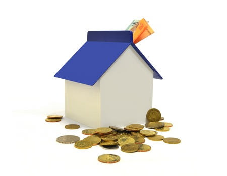 property investment: House and coins, property investment concept