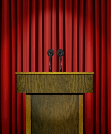 Podium and microphones over red curtains photo