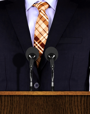 Presentation speech at a podium with microphones photo
