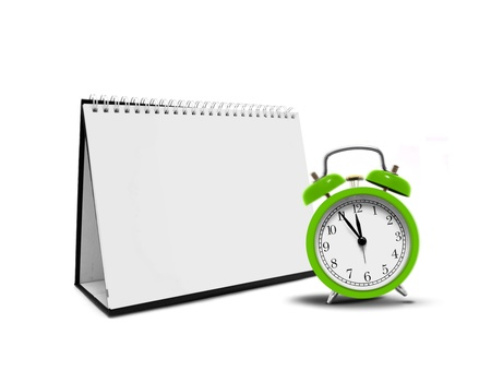 Alarm clock and desktop calender photo