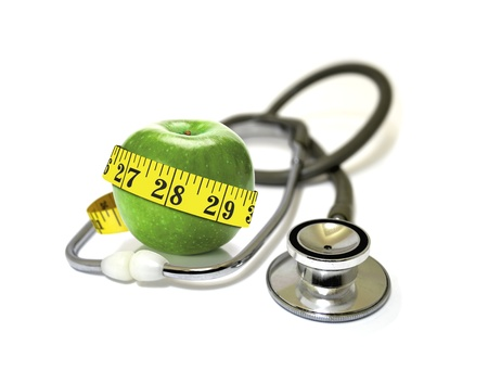 measurement tape: Stethoscope with green apples and measurement tape  Stock Photo