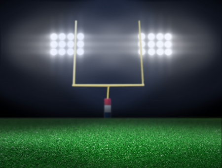 Empty football field with spotlight at night  Stock Photo