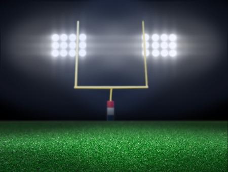 goal line: Empty football field with spotlight at night  Stock Photo