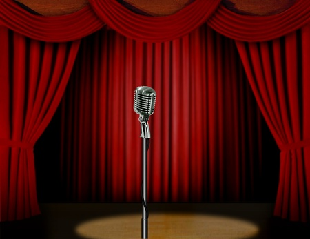 Retro microphone and red curtain on a stage with spotlight photo