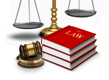 arbitrate: Legal gavel with scales and law books Stock Photo