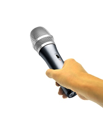 Hand holding microphone on white photo