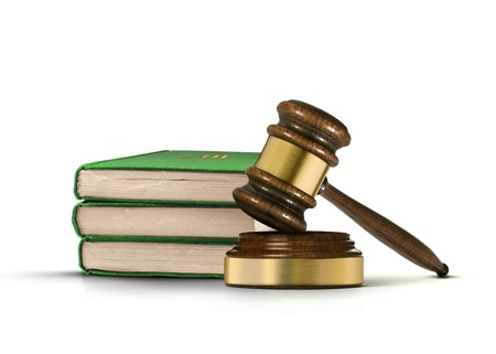 arbitrate: Wooden gavel and books of law Stock Photo