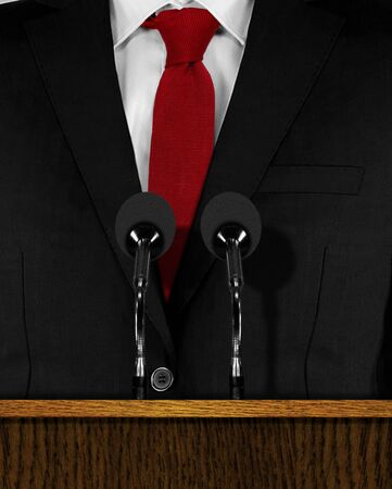 lectern: Press conference  at a podium with microphones