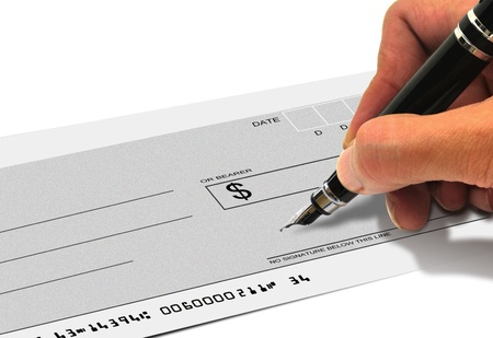 Signing a cheque photo