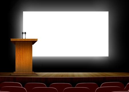 表彰台とプレゼンテーションの画面を持つ会議場 写真素材