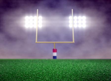 空のフットボール競技場および煙スポット ライト