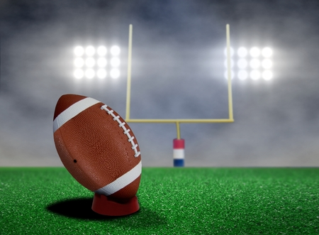 touchdown: Football Free Kick with Spotlights and Smokes Stock Photo
