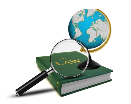 Magnifying Glass and the Book of Law with Globe photo