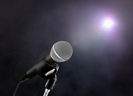 volume glow light: Microphone on Stage with Spotlight Stock Photo