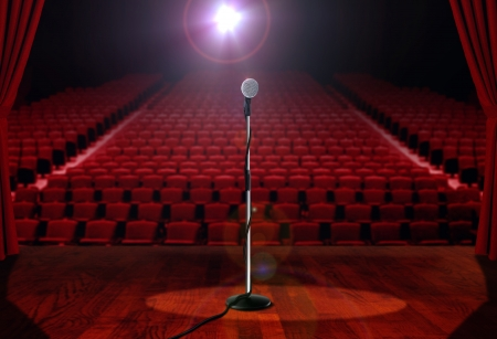 Microphone on Stage with Empty Seats photo