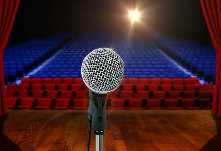 Microphone on stage Facing Empty Seats photo