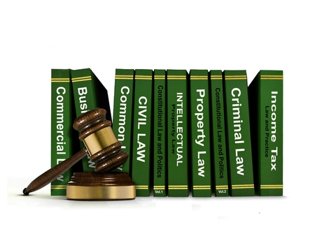 arbitrator: Row of Law Books and Wooden Gavel