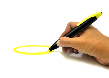 highlighted: Hand Making Circle with Yellow Highlighter