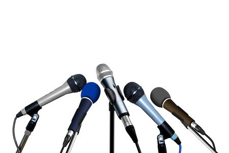 news stand: Press Conference Microphones over White