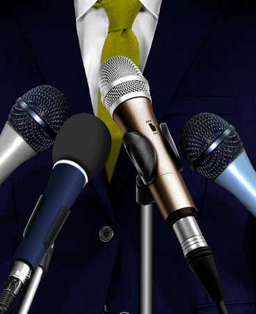 Man Giving Speech Using Microphones Banque d'images