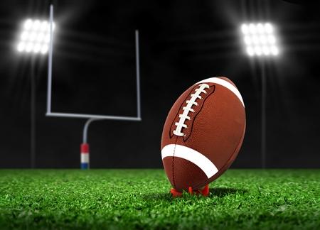 サッカー ボールのスポット ライトの下で芝生の上