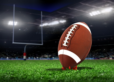 Football Ball On Grass in a Stadium photo