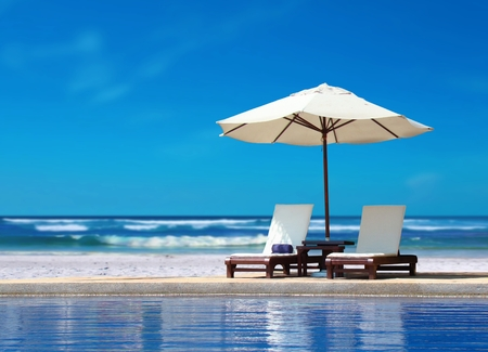 recliner: Two Chairs with White Umbrella near the Beach