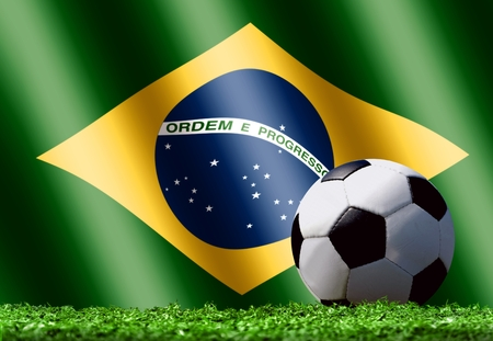 Soccer Ball on Grass with Brazilian Flag photo