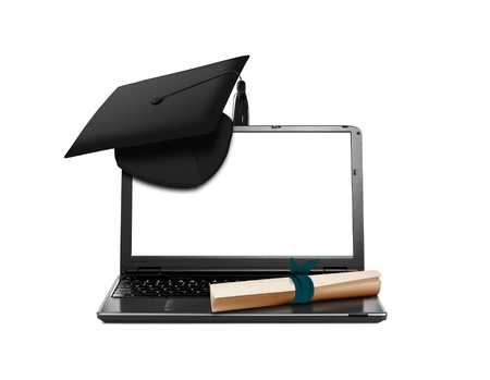 Laptop with Mortarboard and Scroll Education Concept photo
