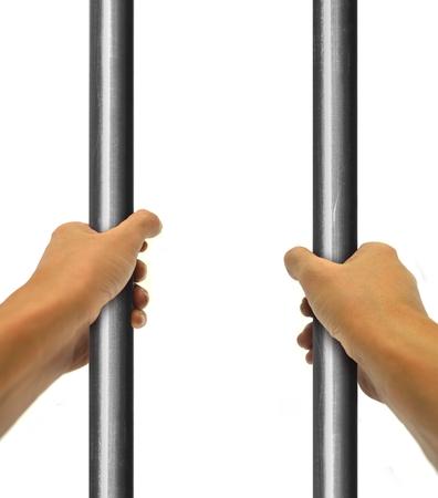 man in jail: Hand Behind Bar Stock Photo