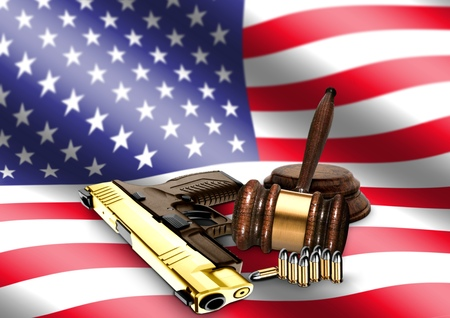 Gavel and Hand Gun with American Flag photo